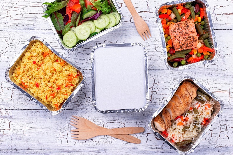 a selection of 5 healthy food delivery options on a table