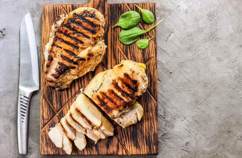 grilled chicken breast on a cutting board