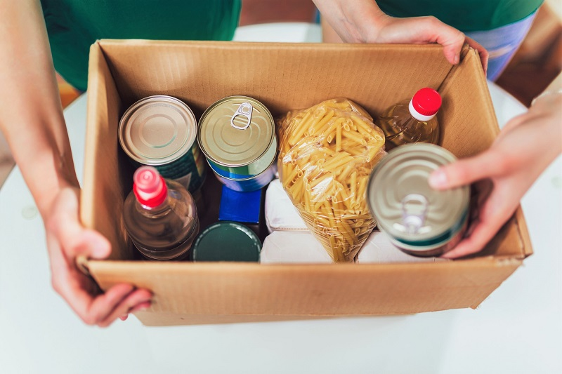 a box of canned goods and pantry items