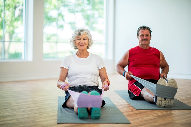 a man and a woman doing resistance band training exercises