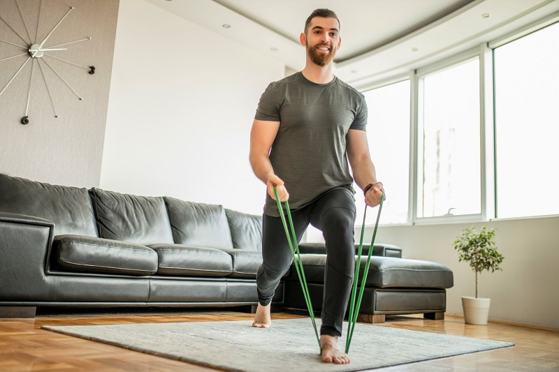 a man doing lunges with a resistance band