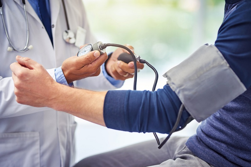 a doctor measuring a patient's blood pressure