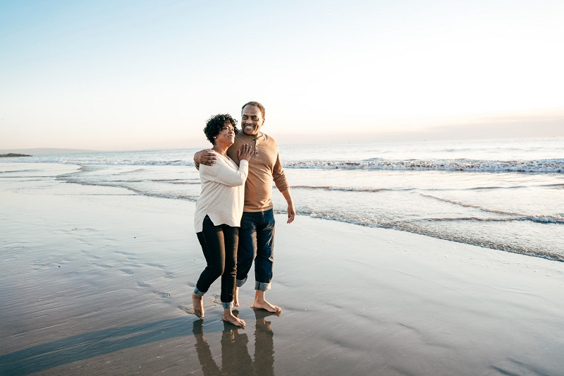 couple walking on the beach in summer
