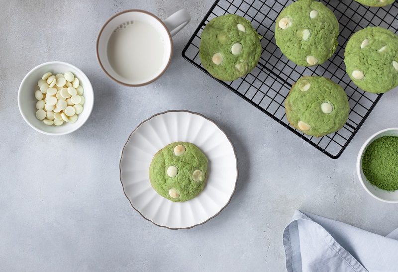 matcha cookies with white chocolate on a plate with milk