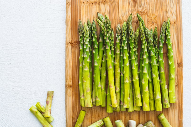 Asparagus on a Wooden Chopping Board