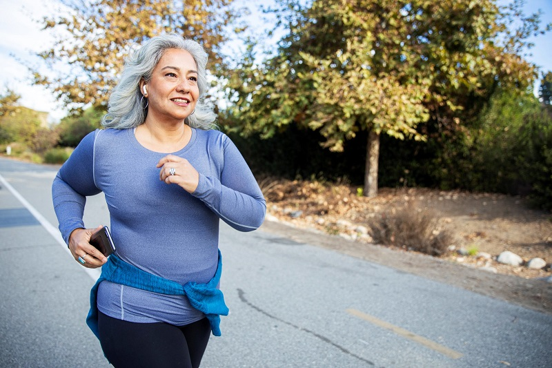 Woman power walking on the street to burn more calories