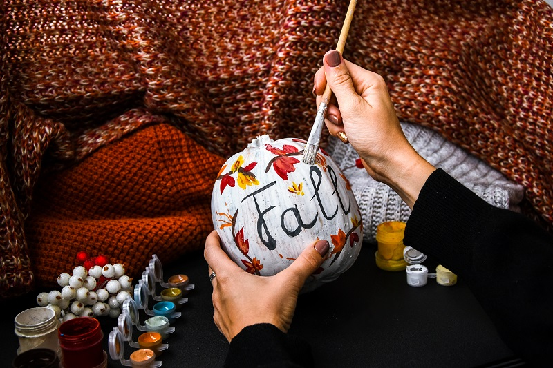 Practice fall self-care through painting gourds or making other autumn decorations